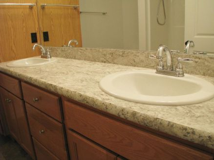 2444 Master bath vanity counter with two sinks with high rise faucets