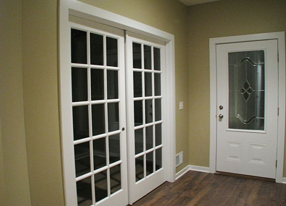 French glass panel double doors to office (den or bedroom).