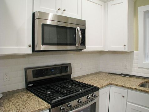 Gas stove with built-in microwave above.