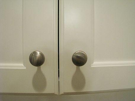 Door knobs on cabinets.