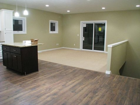 Dining area with laminate wood floor to living room.