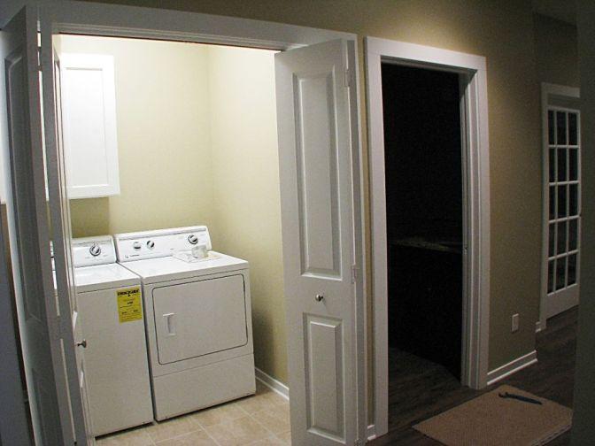 Laundry with 4-panel bi-fold doors.
