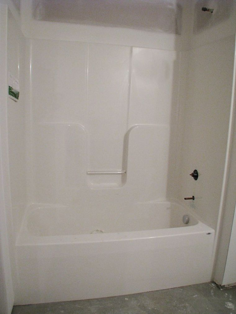 one piece tub shower combination in lower level.