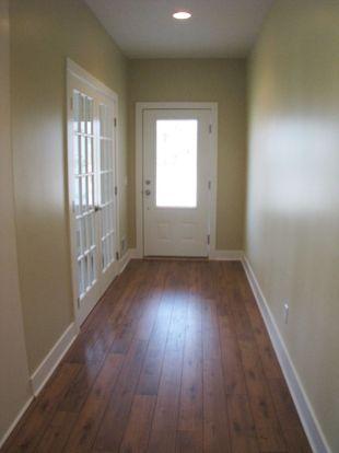 2502 Foyer, laninate wood floor, glass panel doors lead to office in the left