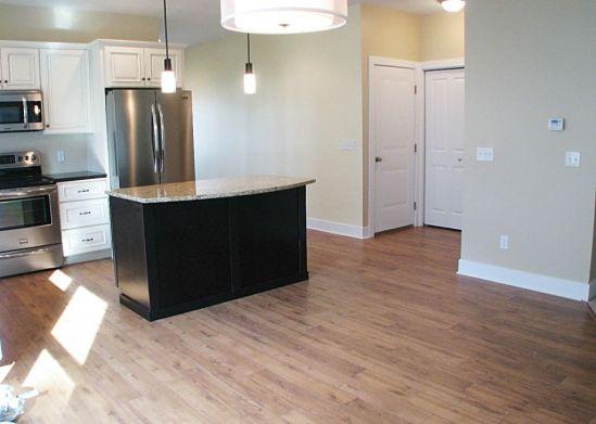 2502 Kitchen center island, laminate wood floor