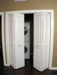 2437 4-panel bi-fold doors enclose laundry