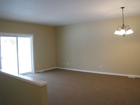 2419 Living room with stairway to lower level on the left