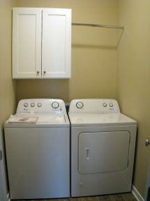2419 Laundry with storage cabinet & hanging clothes bar