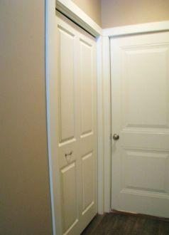 Unit 2515 Back entry door and closet | Sawgrass Condos in Holland, MI