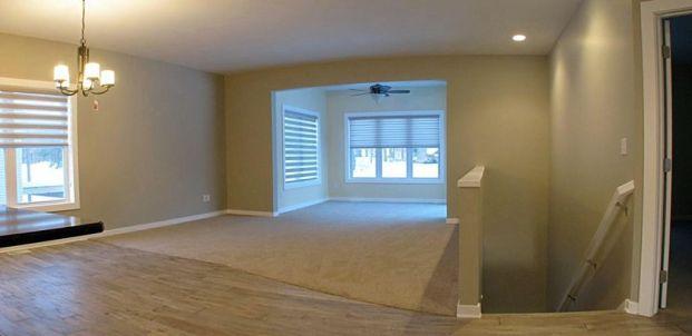 View of living room and 4-season room