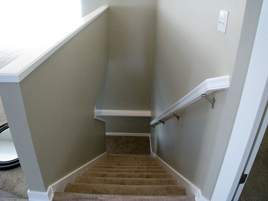 Carpeted stairway with railing