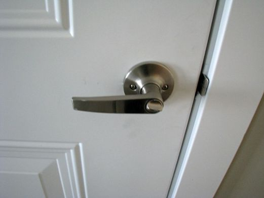 Lever type door handle on door to garage