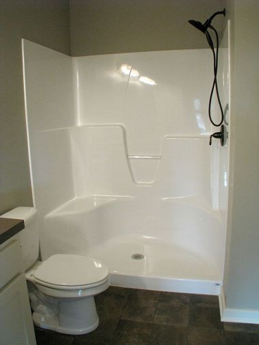 One piece step in shower with seat.