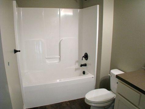 One piece tub in lower level full bath.
