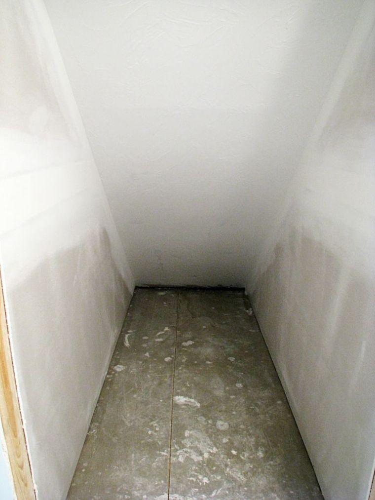 Lower level under stairs storage