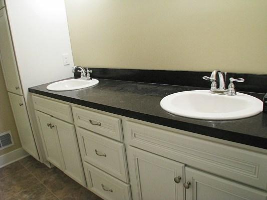 Master bath-counter 2 sinks, black quartz