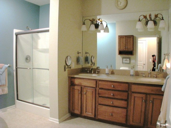 cabinets wood, Corian counter and glass walk in shower