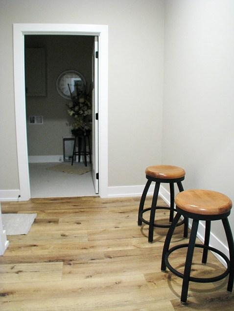 Mud room with entrance to half bath by back door