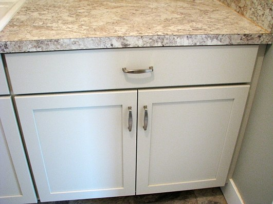Counter & white cabinet in Laundry