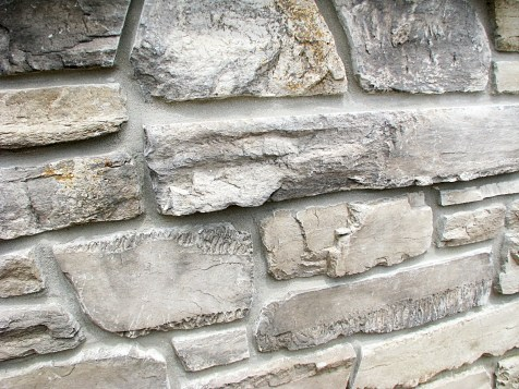 Stacked stone exterior trim on front of unit