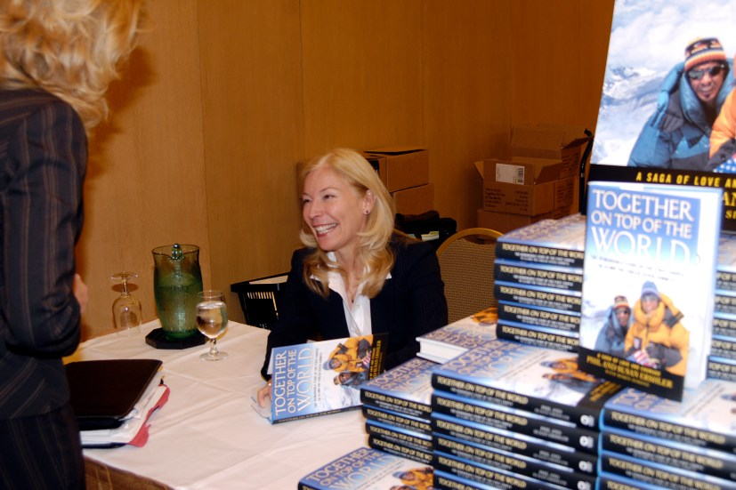 Susan signing books at United Way
