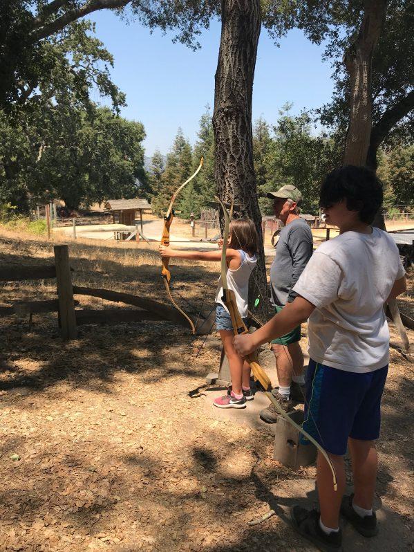 Camp Grandma Archery with cousins