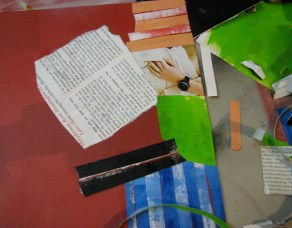 pasting down paper scraps for collage