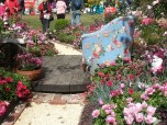One view of the blue chair - note the pink gnome