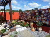 Young designer section - great idea for a wall! She also had coloured lights in mason jars hanging around the pergola.