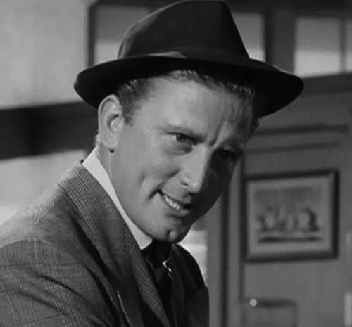 Kirk Douglas as Chuck Tatum in Ace in the Hole