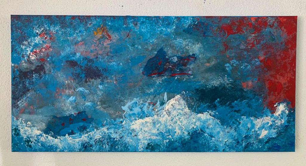 Ein Bild, bei dem vorwiegend mit blau und rot gemalt wurde