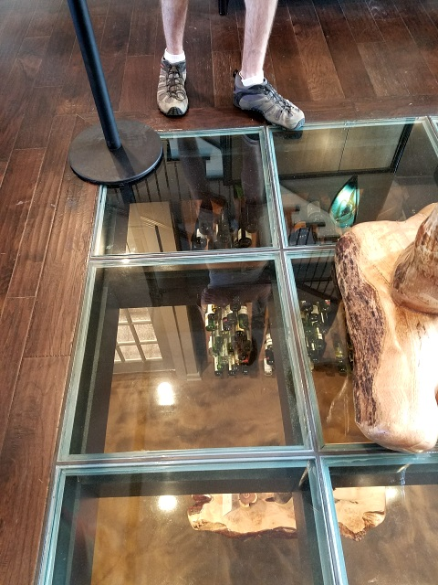 Glass floor with view of wine cellar