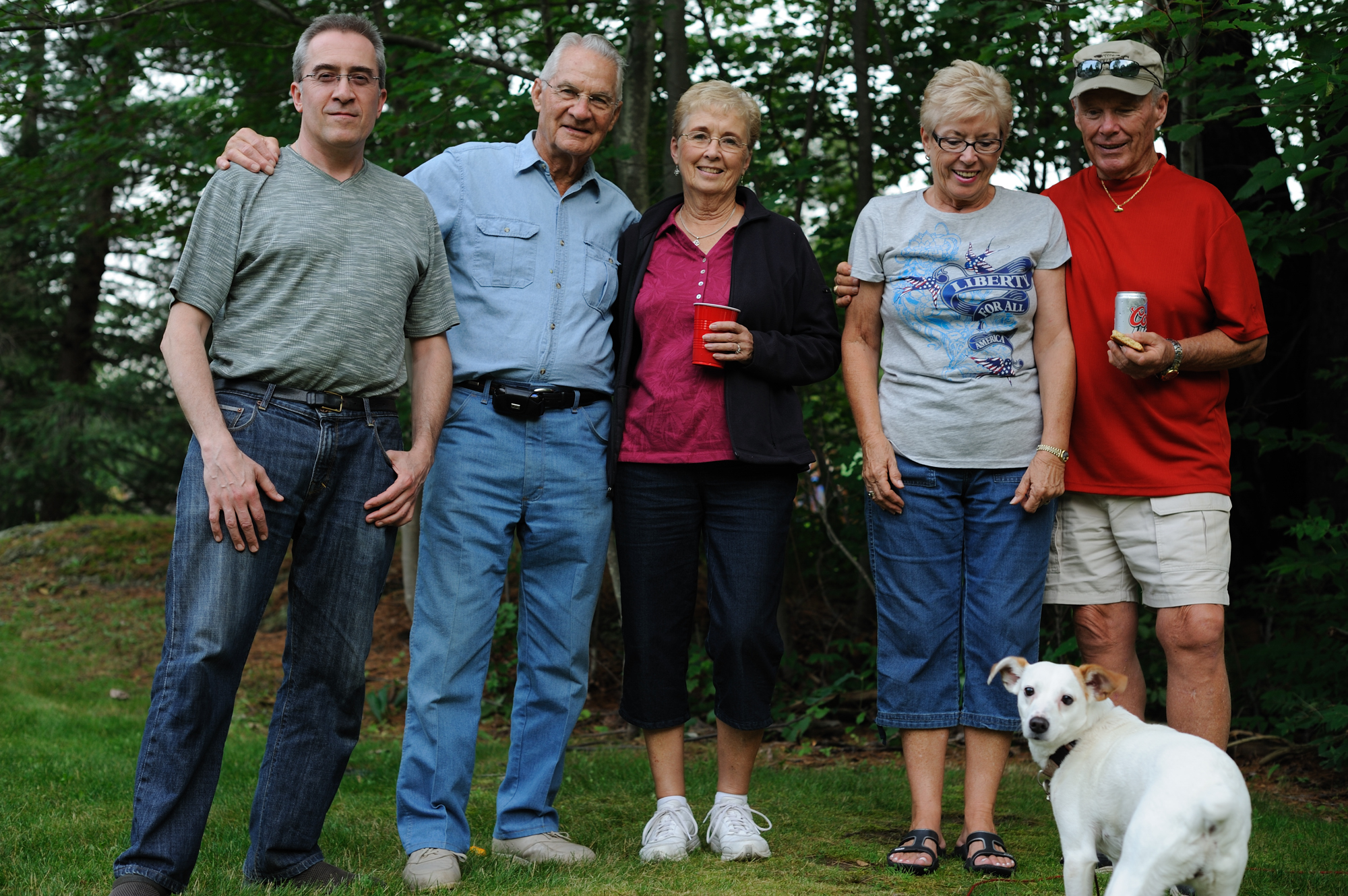 Family posing with dog