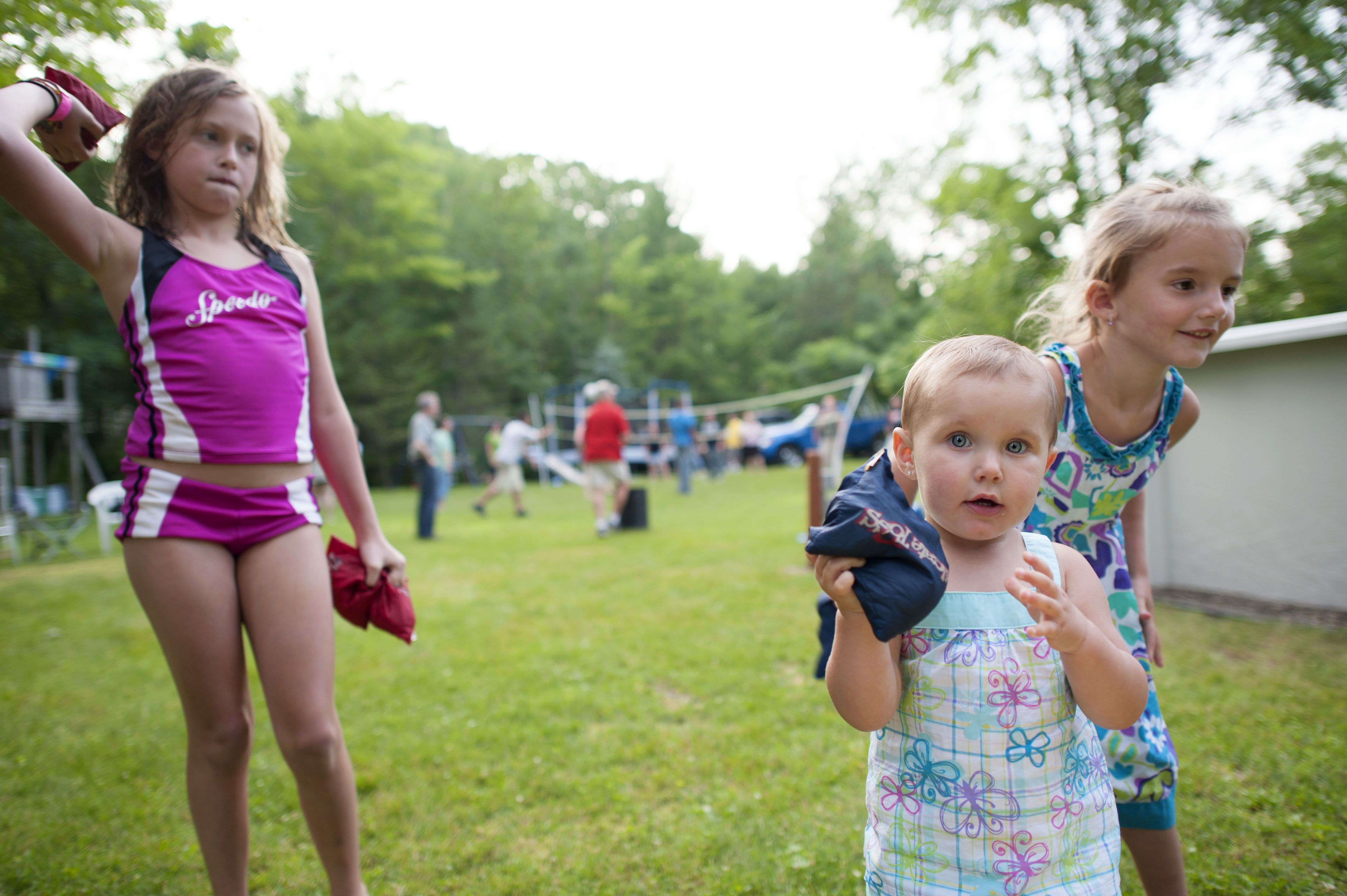 Small children at a Fourth of July backyard party.
