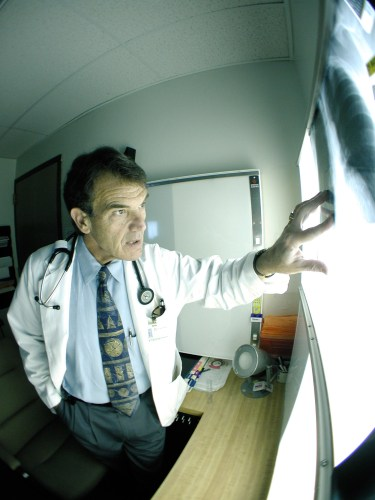 Raymond Sabatelli, MD examines an X-ray.
