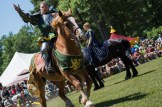 Joust performer welcomes the crowd to a performance at a Renaissance Festival.