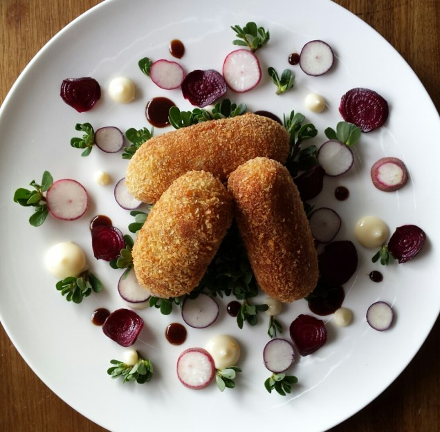 Sweet potato, roo tail and native herb croquettes with accompaniments from the earth