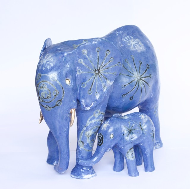Blue mother and child ceramic elephants with matching patterns inspired by mid century fabric