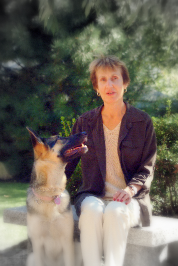Lillian, a reader, and her guide dog Lucy