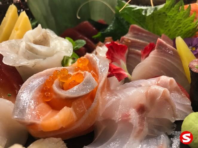 hirame (halibut), sake (salmon) with ikura (salmon roe), maguro (tuna), tako (octopus), kanpachi (amber jack), suzuki (sea bass) sashimi