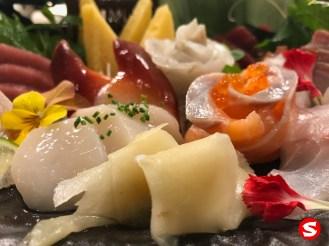 hotategai (scallop), hokkigai (surf clam), tamago yakii (egg omelet), hirame (halibut), sake (salmon) with ikura (salmon roe) sashimi