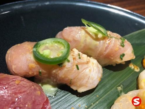 suzuki (sea bass) nigiri with jalapeño sauce