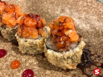 maguro (tuna back) tempura maki (fried roll) with sake (salmon) topping closeup