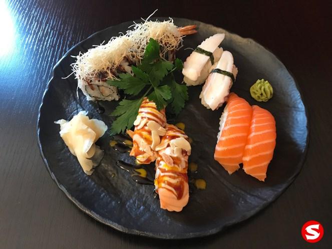 ebi tempura (deep fried shrimp) uramaki (inside out roll), sake yaki (grilled salmon), tako (octopus), sake (salmon) nigiri