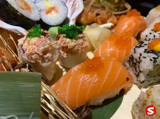 tarabagani maki (king crab roll) with green tobiko (flying fish roe), sake (salmon) nigiri with ikura (salmon roe)