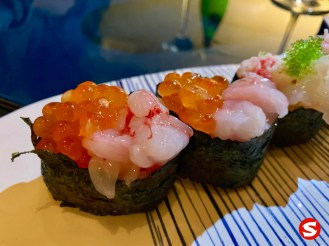 red ebi (shrimp) gunkan (battleship sushi) with ikura (salmon roe)