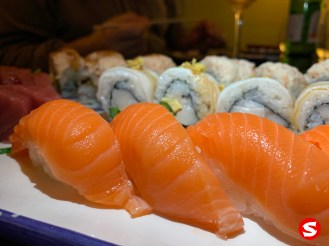 sake (salmon) nigiri, kani (crab meat) uramaki (inside out roll) with ibodai (butterfish) and truffle topping