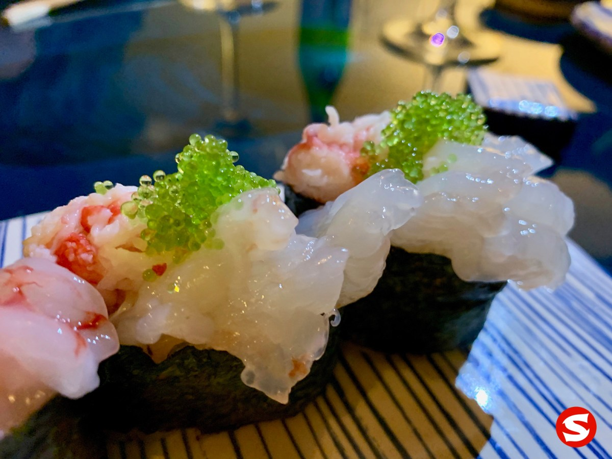white ebi (shrimp) gunkan (battleship sushi) with green tobiko (flying fish roe)