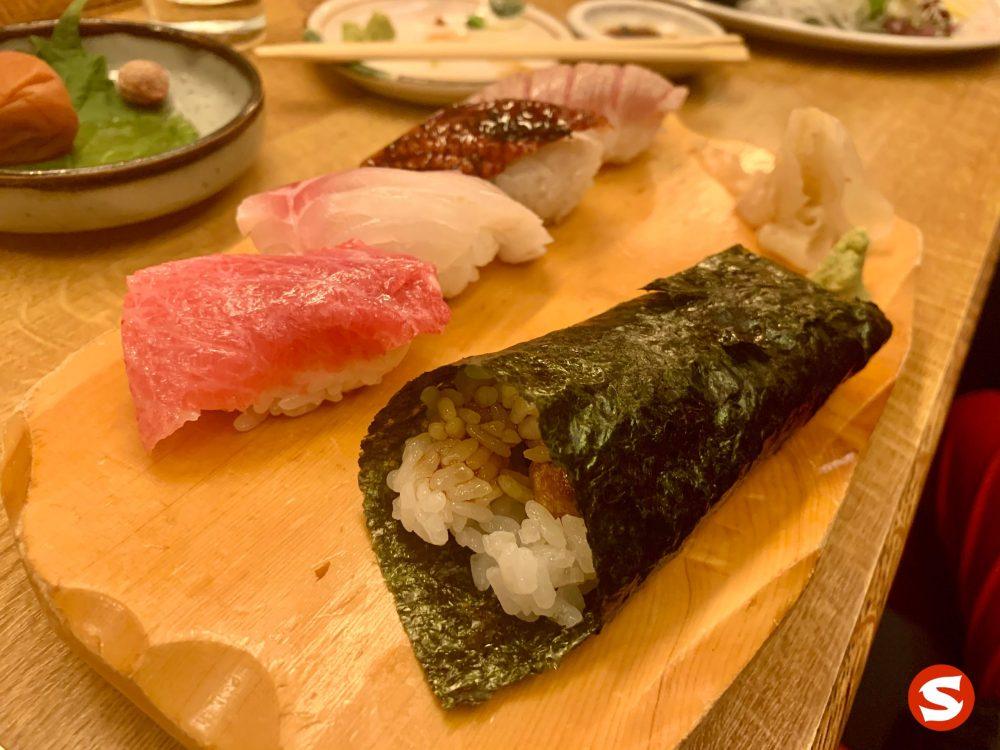 sake cava temaki (handroll with grilled salmon skin), otoro (fatty bluefin tuna belly), madai (red seabream), unagi (freshwater eel), zuke chu toro (seared and flambeed medium fatty bluefin tuna belly) nigiri plate