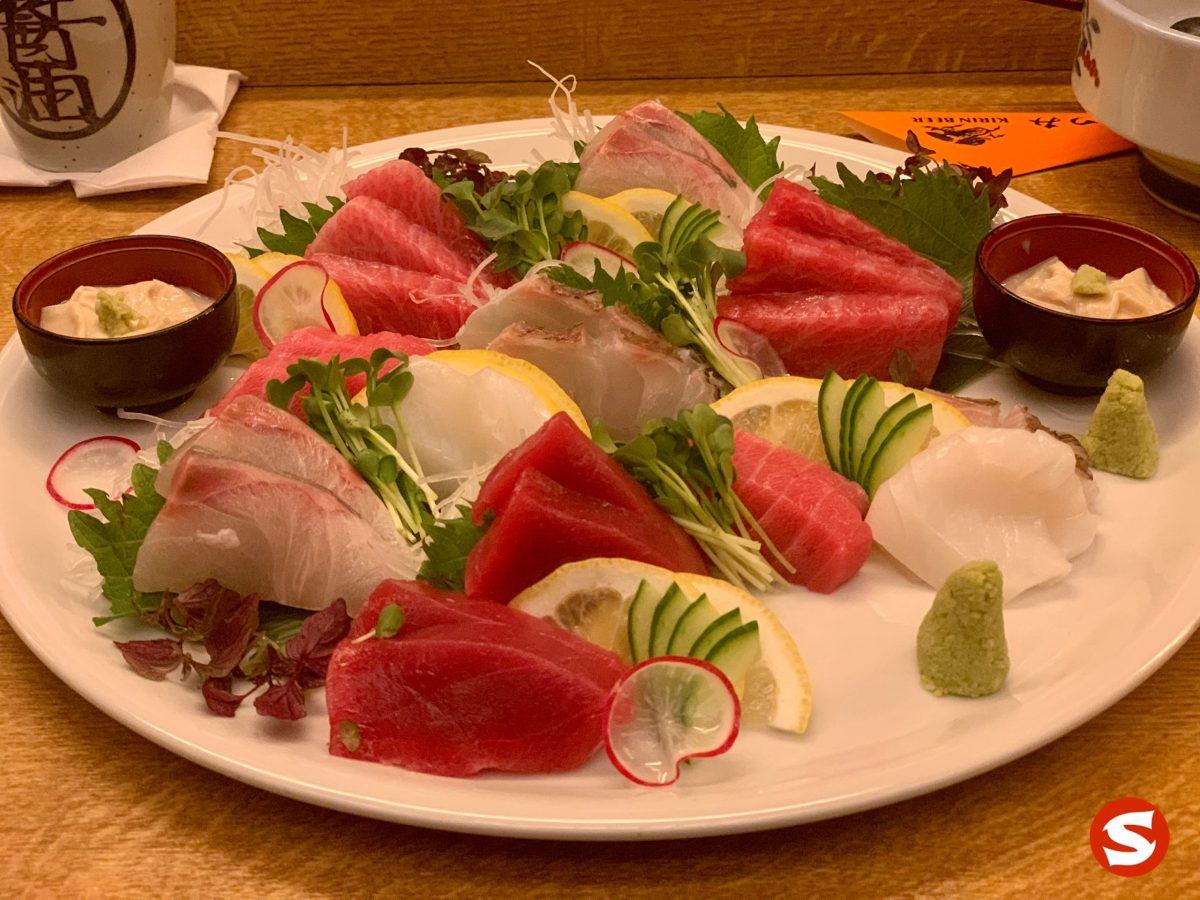 shima aji (striped jack), otoro (bluefin fatty tuna belly), chu toro (medium fatty bluefin tuna belly), madai (red seabream), ika (squid), maguro (bluefin tuna back) sahimi plate with wasabi